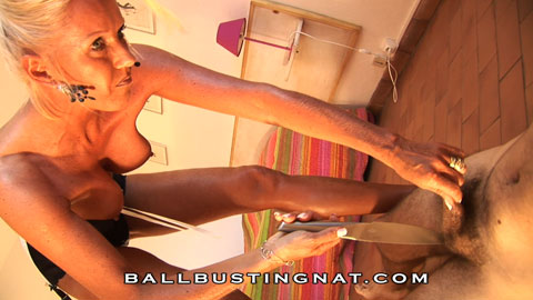 I'm Mistress Nat. Ballbusting and nut squeezing are my intimate pleasures. Come and play with my nutcracker!